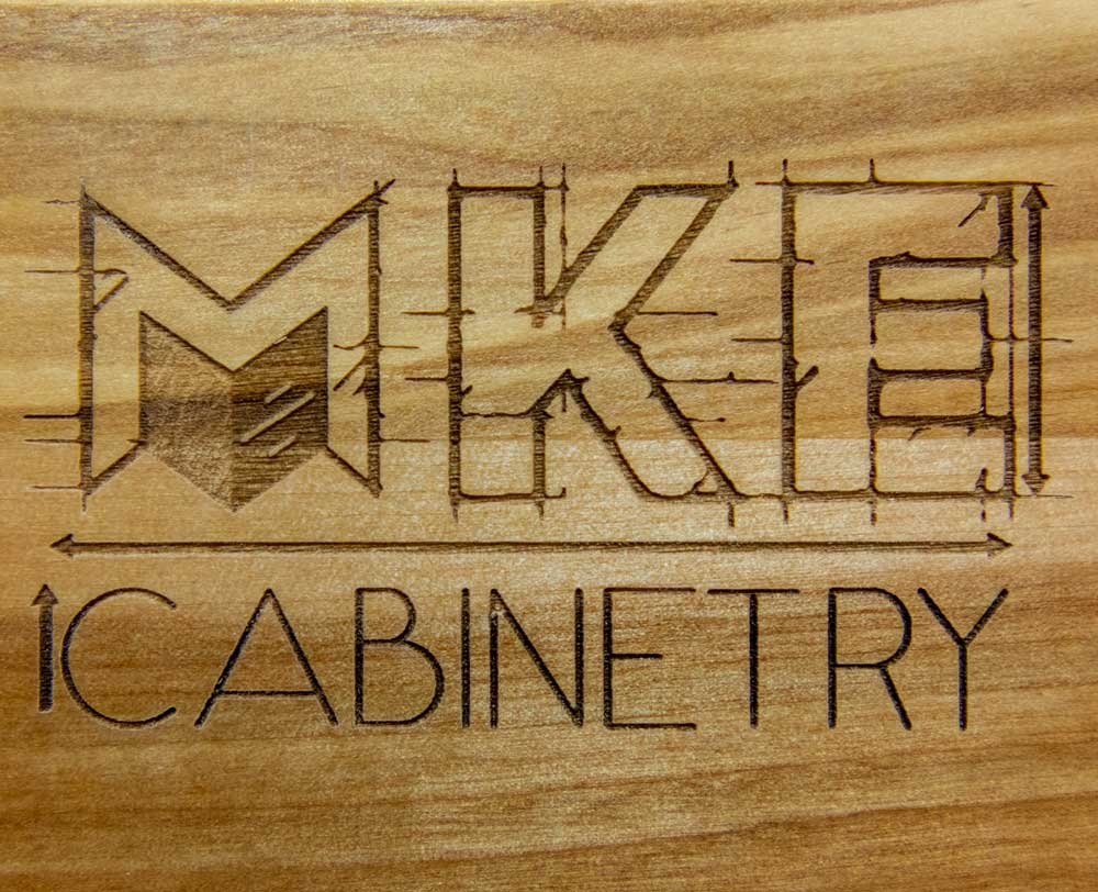 MKE Cabinetry logo on wood
